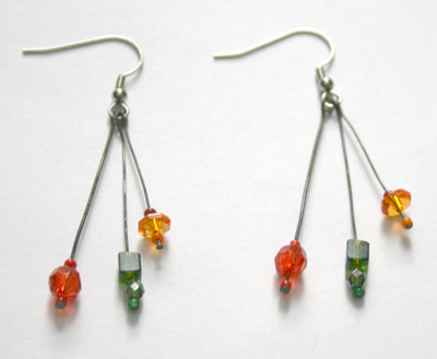 Green, orange and red triple earrings
