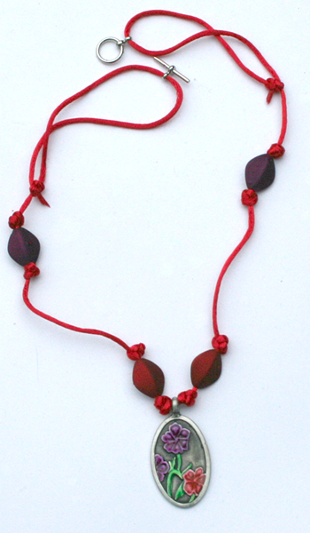 Red cord metal pendant