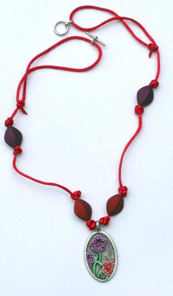 Red cord metal pendant