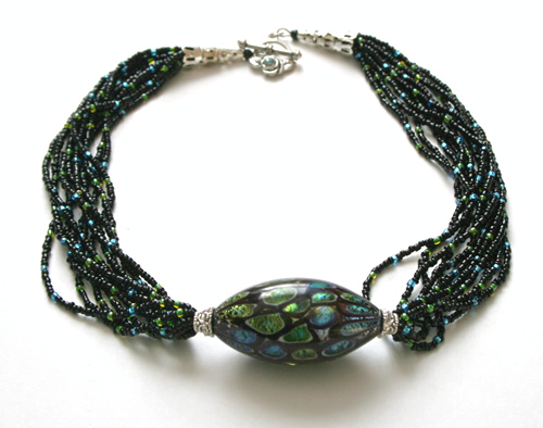 Beading: Glass pendant, blue, green, black bead necklace