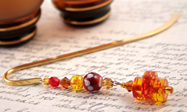 Gold-tone bookmark #15, amber, red, and yellow, with amber drop, etsy, writing and two glasses, medium