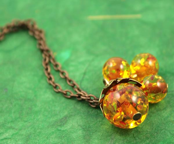 Sunlight bubbles necklace, etsy, green bg closeup, medium
