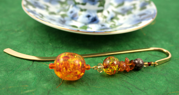 Amber cave gold plated bookmark, etsy, green bg, medium