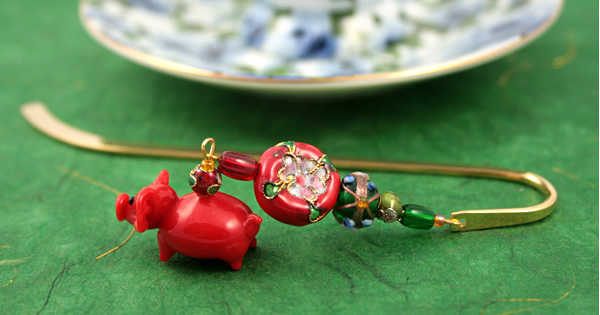 Chinese piggy gold plated bookmark, etsy, green bg, medium