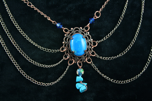 Blue howlite brass decollete necklace, on black, md