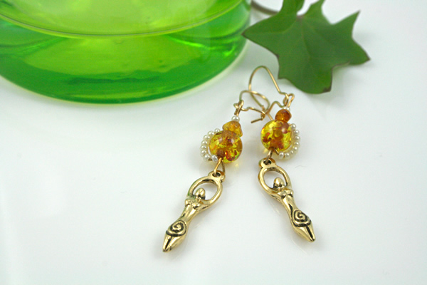 Golden amber birth goddess earrings, leaf, md