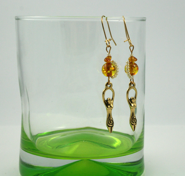 Golden amber birth goddess earrings, md