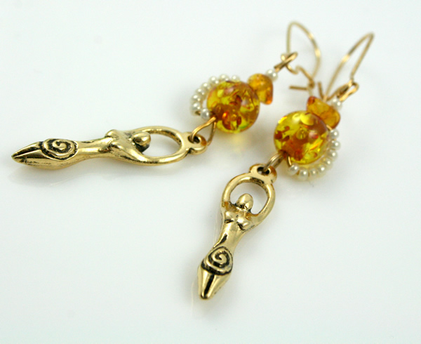 Golden amber birth goddess earrings, on white, md