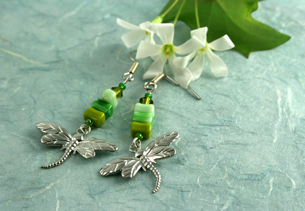 Green dragonfly earrings, on blue, md
