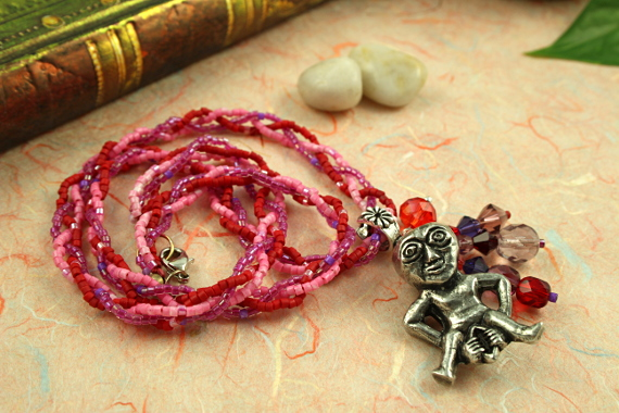 Sheela-na-gig rose and lilac necklace, circle, md