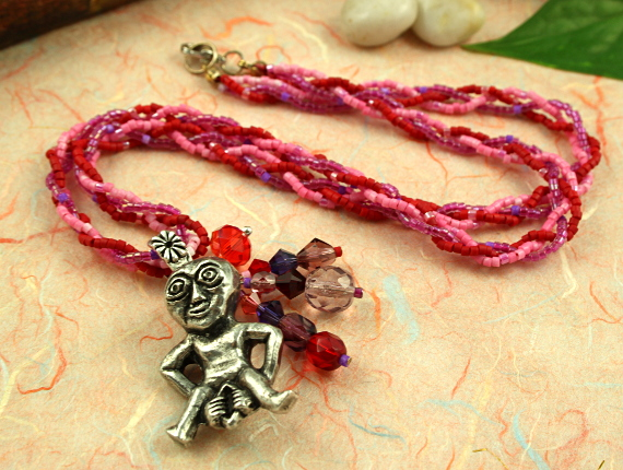 Sheela-na-gig rose and lilac necklace, closeup, md