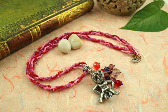 Sheela-na-gig rose and lilac necklace, semi, md