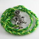 Spring Green Sheela-na-gig necklace, circle, md