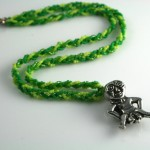 Spring Green Sheela-na-gig necklace, floating, md