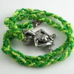 Spring Green Sheela-na-gig necklace, from back, md