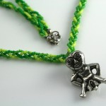 Spring Green Sheela-na-gig necklace, on string, md