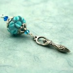 Blessingway bead turquoise flower goddess on blue, med