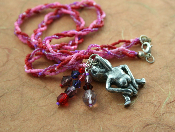 Rose and lilac Sheela Na Gig necklace with charms, back, md