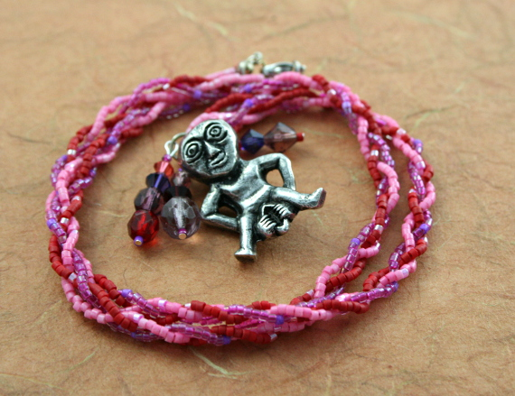 Rose and lilac Sheela Na Gig necklace with charms, circle, md