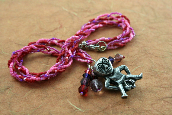 Rose and lilac Sheela Na Gig necklace with charms, infinity, md