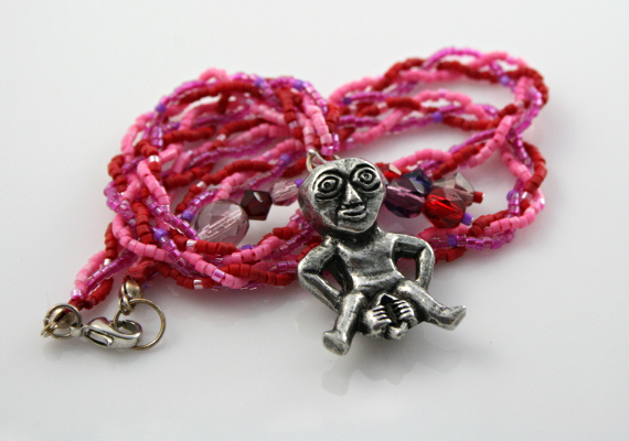 Rose and lilac Sheela Na Gig necklace with charms, white bg, md