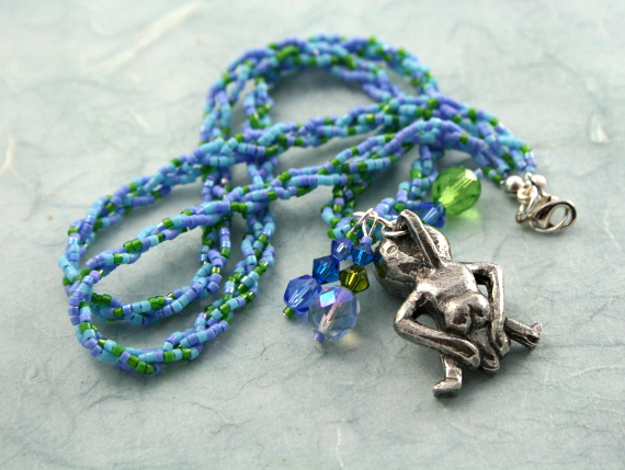 Spring Green Sheela-na-gig necklace with charms, back, md