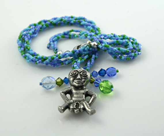 Spring Green Sheela-na-gig necklace with charms, front, md