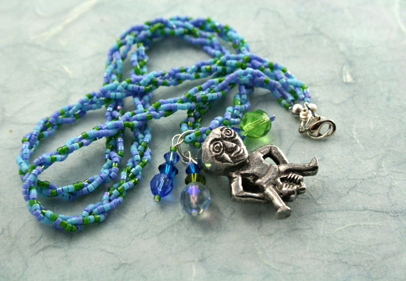 Spring Green Sheela-na-gig necklace with charms, infinity, md
