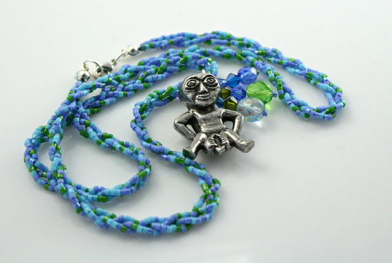 Spring Green Sheela-na-gig necklace with charms, loop, md