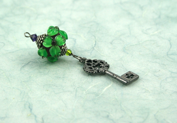 Blessingway bead - Emerald flower key, blue, md