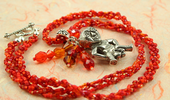 Sheela-na-gig fertility necklace, red, orange, earth, circle, md