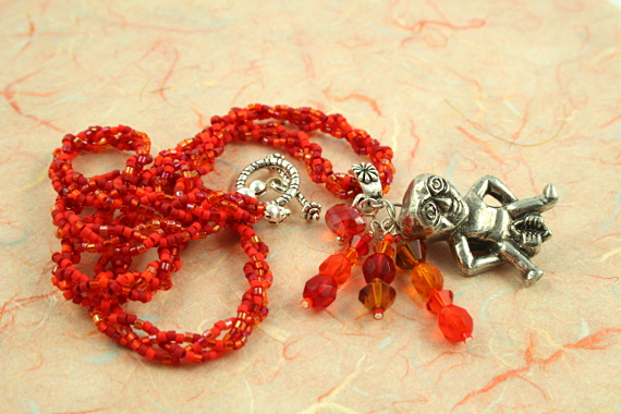 Sheela-na-gig fertility necklace, red, orange, earth, full curl, md