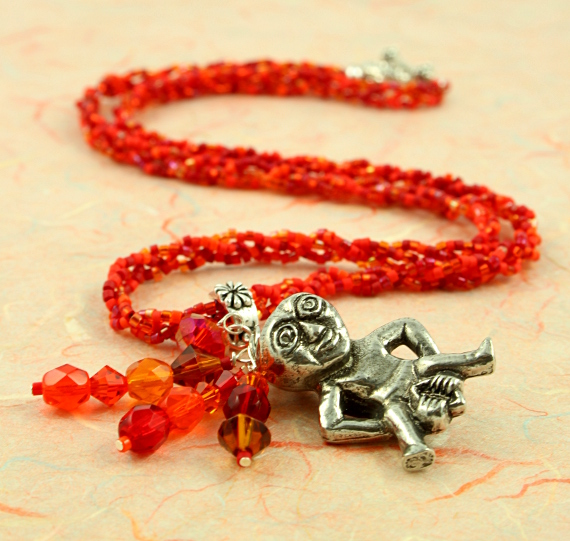 Sheela-na-gig fertility necklace, red, orange, earth, full, md