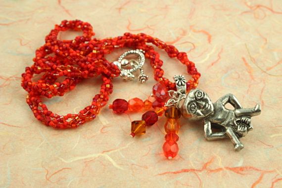Sheela-na-gig fertility necklace, red, orange, earth, soft, md