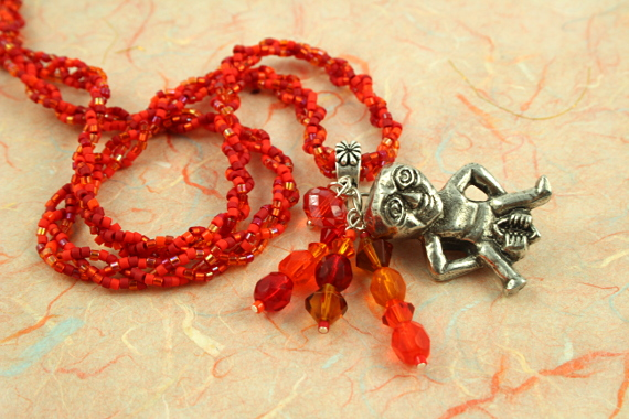 Sheela-na-gig fertility necklace, red, orange, earth, swirl, md