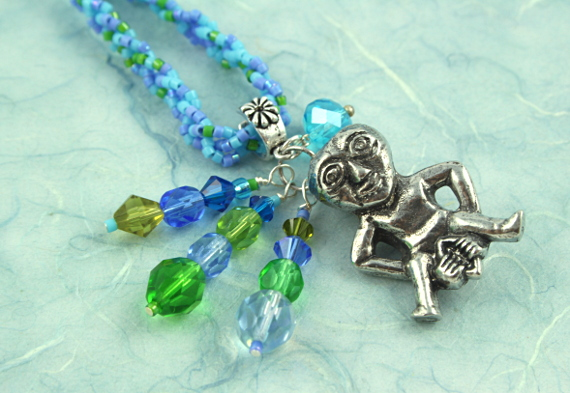 Sheela-na-gig necklace - blue and green, closeup, md
