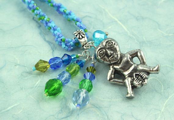Sheela-na-gig necklace - blue and green, closeup, md