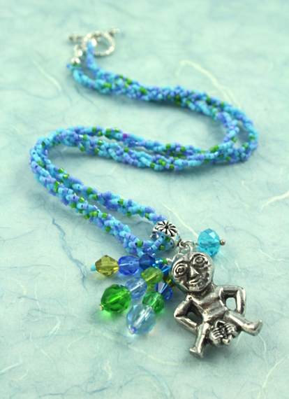 Sheela-na-gig necklace - blue and green, full length, md