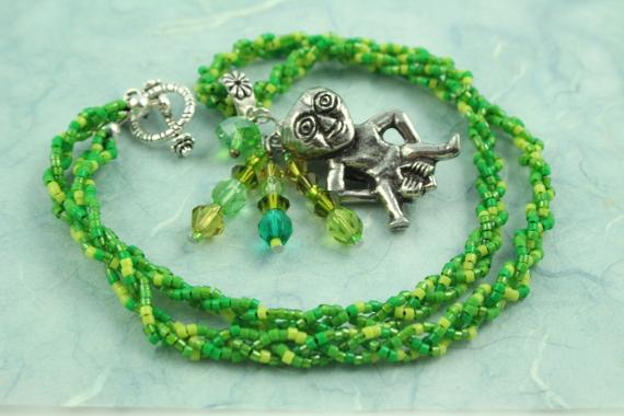 Sheela-na-gig necklace, green, circle, md