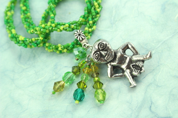 Sheela-na-gig necklace, green, closeup, md