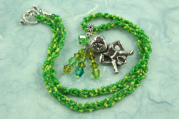 Sheela-na-gig necklace, green, full, md