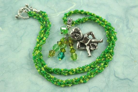 Sheela-na-gig necklace, green, full, md