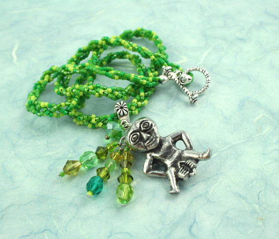 Sheela-na-gig necklace, green, heap, md