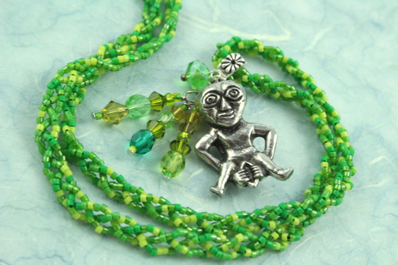 Sheela-na-gig necklace, green, spiral, md