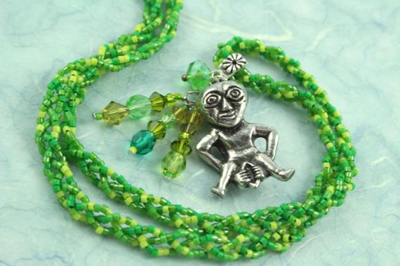 Sheela-na-gig necklace, green, spiral, md