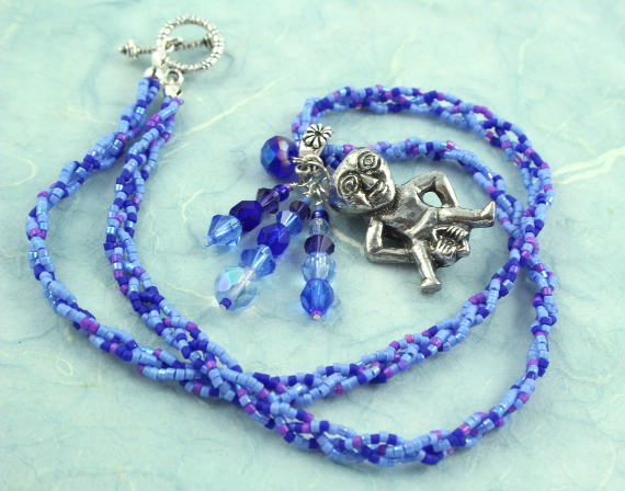 Sheela-na-gig necklace - purple and blue, circle, md