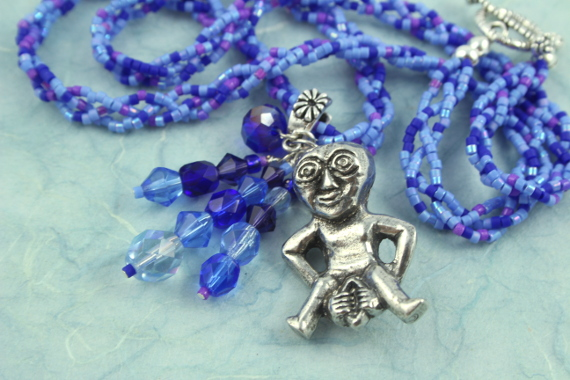 Sheela-na-gig necklace - purple and blue, heap closeup, md