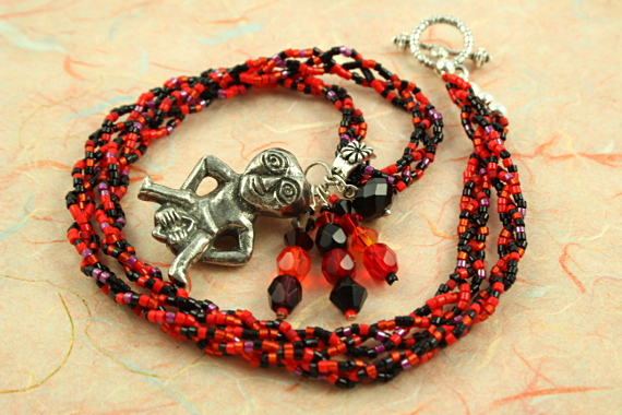 Sheela-na-gig necklace - red and black, circle, md