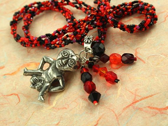 Sheela-na-gig necklace - red and black, closeup, md